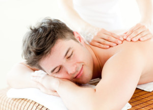 Relaxed young man receiving a back massage